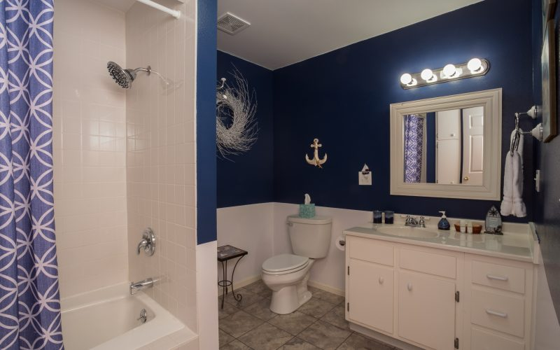 Hidden Harbor bathroom is beautifully decorated in blues and whites and offers a soaking tub
