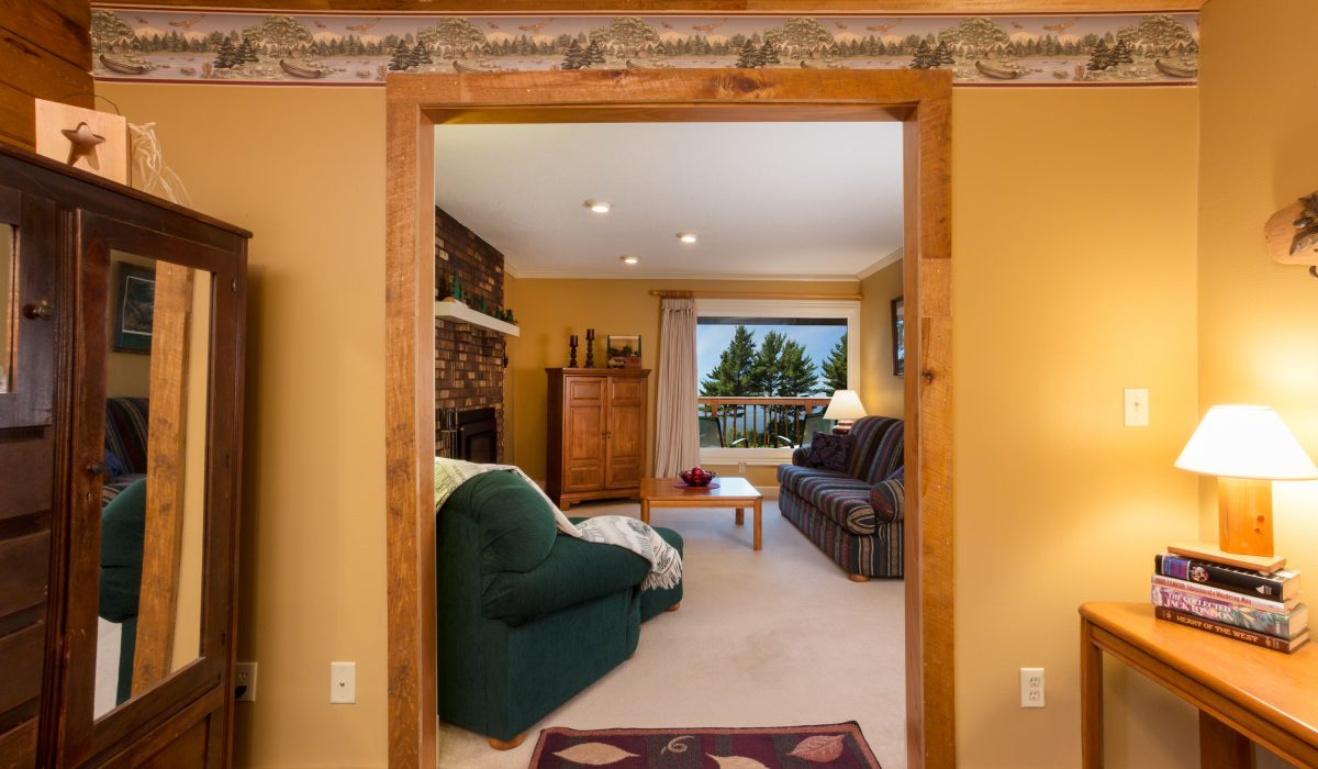 Feel the history of Chippewa Falls in a cabin-like lakeside suite with rustic lumberjack and hunting decorations