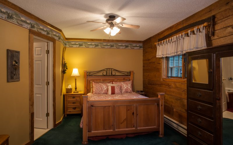 The bedroom in the Northwoods Suite had a queen size bed, a chiffarobe to hang your clothes, and a private bathroom.
