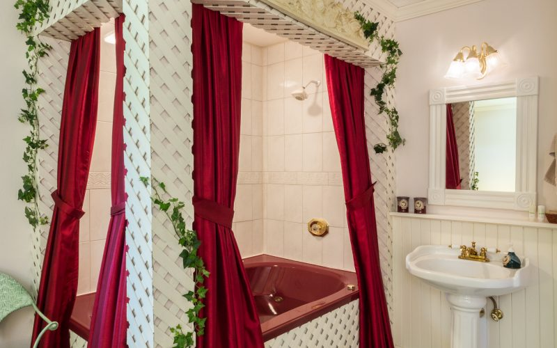The double whirlpool in Secret Garden is red and framed with lattice.