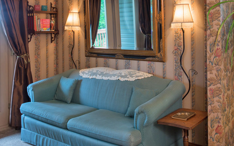 The sitting area in the Cozy Corner room makes it a relaxing suite