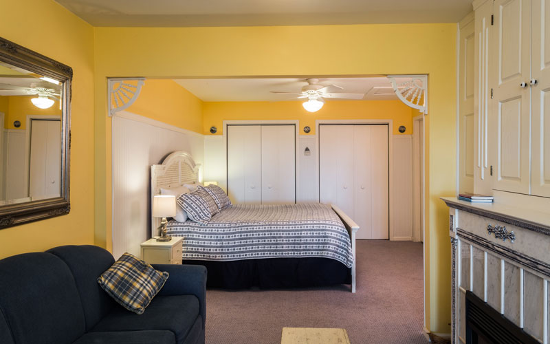 One of two nautically themed guest rooms, the Hidden Harbor room is a suite with access to a patio overlooking the lake. Enjoy the luxury of sleeping in a king size bed, lounging on the couch by the fireplace, and of course, your own private bathroom.