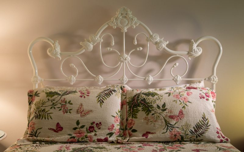 The Secret Garden room has an old fashioned white iron bed