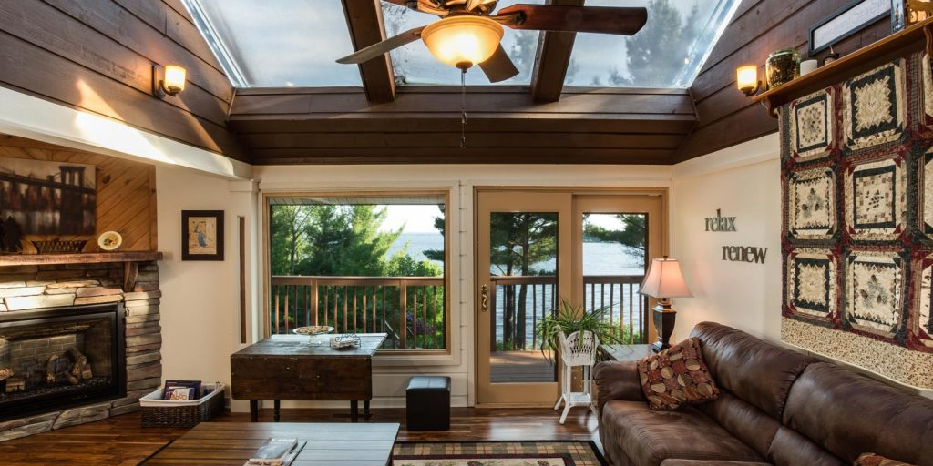 The common area features a gas fireplace, comfy seating and a breathtaking view of Lake Wissota.