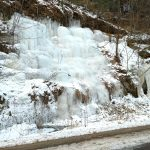 Frozen waterfall on limestone wall at Irvine Park